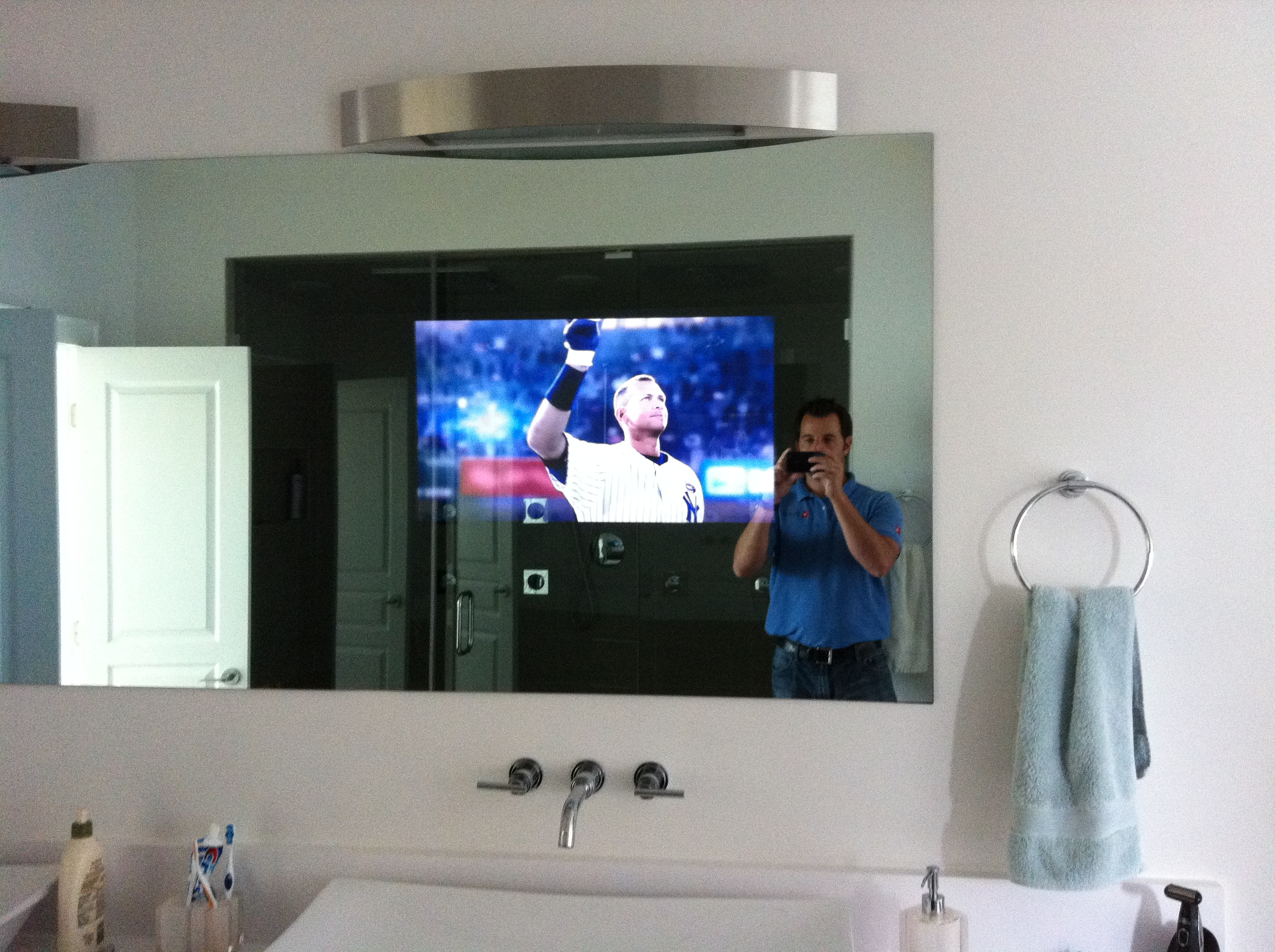 tv behind bathroom mirror nc bathroom tv installation home theater solutions 21060